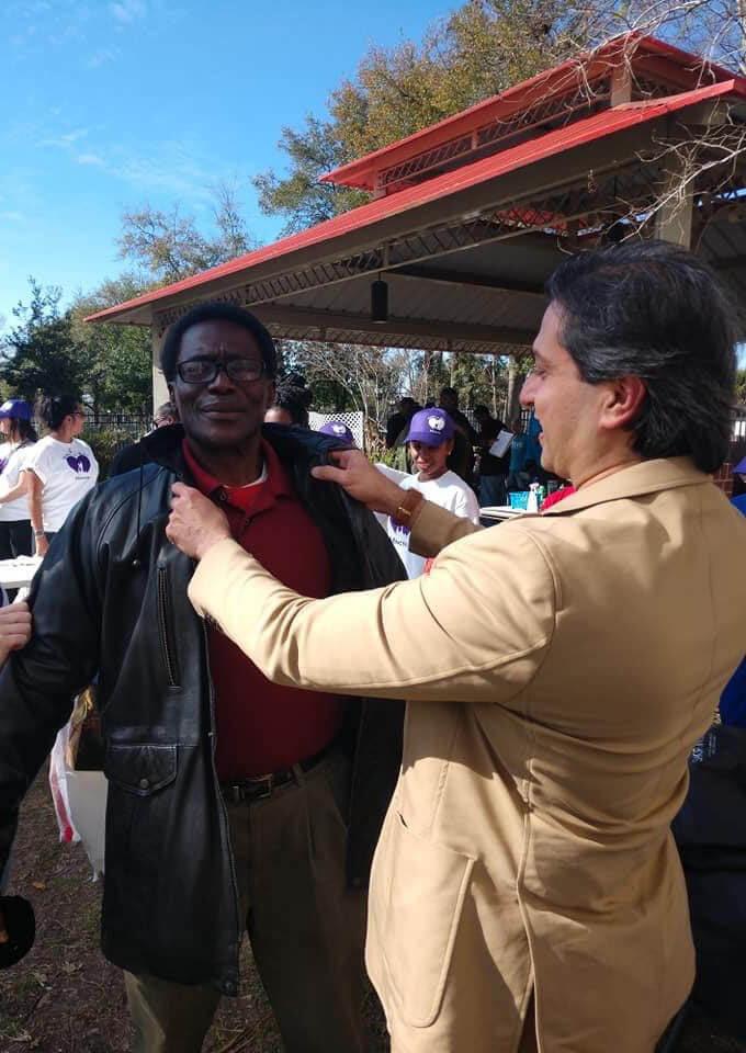Dr. Gulani Fixing Someone's Jacket