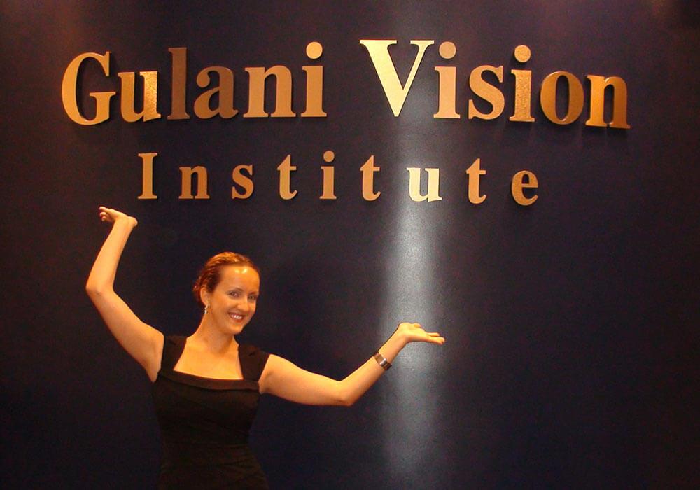 Woman Highlighting Gulani Vision Institute Logo