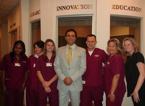 Dr. Gulani With Staff