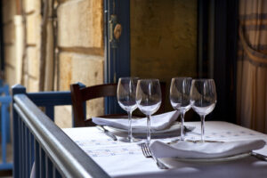 An empty table with wine glasses